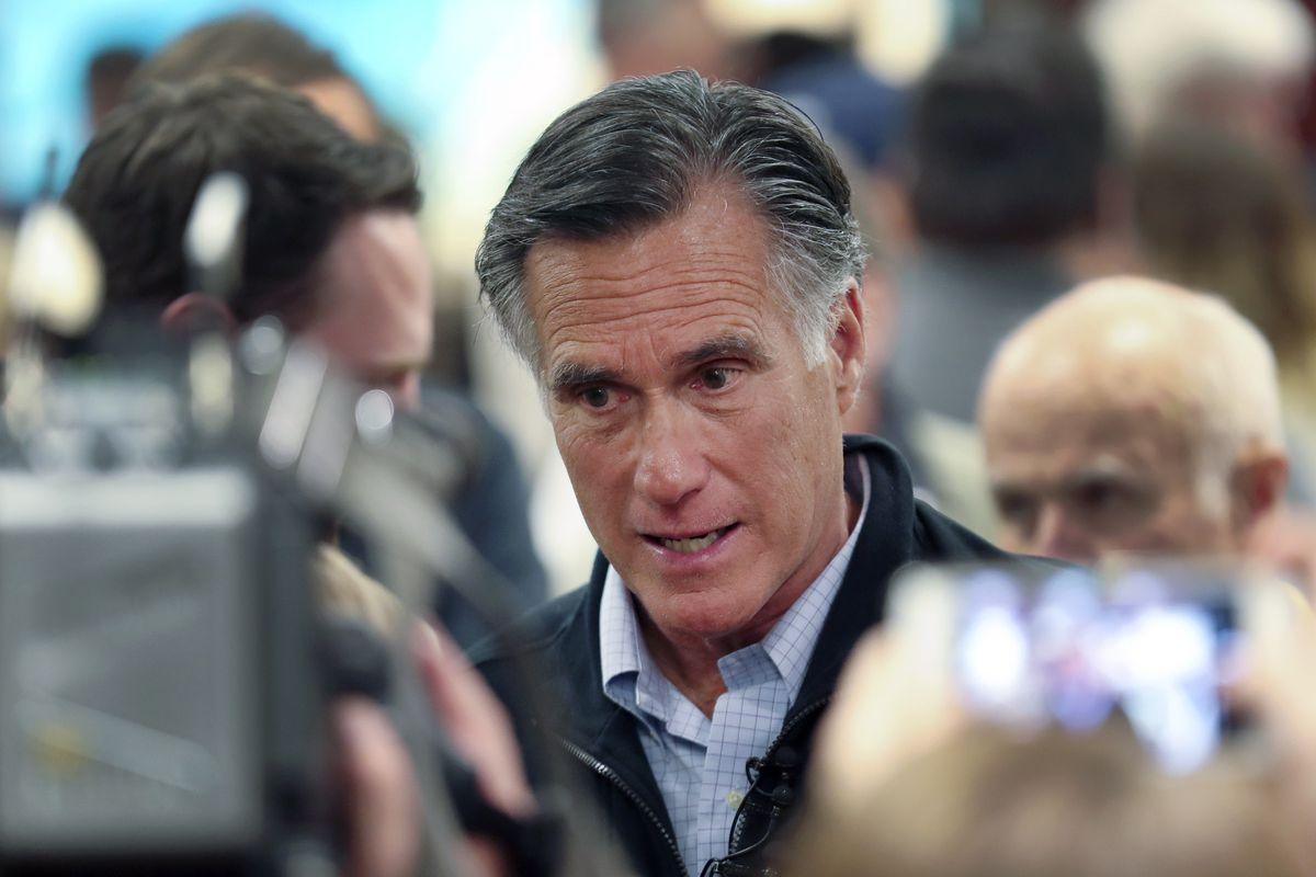 U.S. Sen. Mitt Romney, R-Utah, speaks with audience members following a town hall meeting in Farmington in 2019.