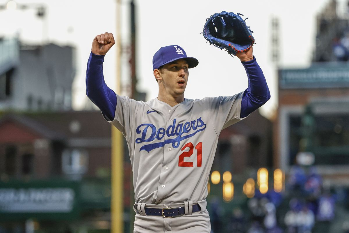 Los Angeles Dodgers starting pitcher Walker Buehler (21) reacts after pitching against the Chicago Cubs during the third inning at Wrigley Field.