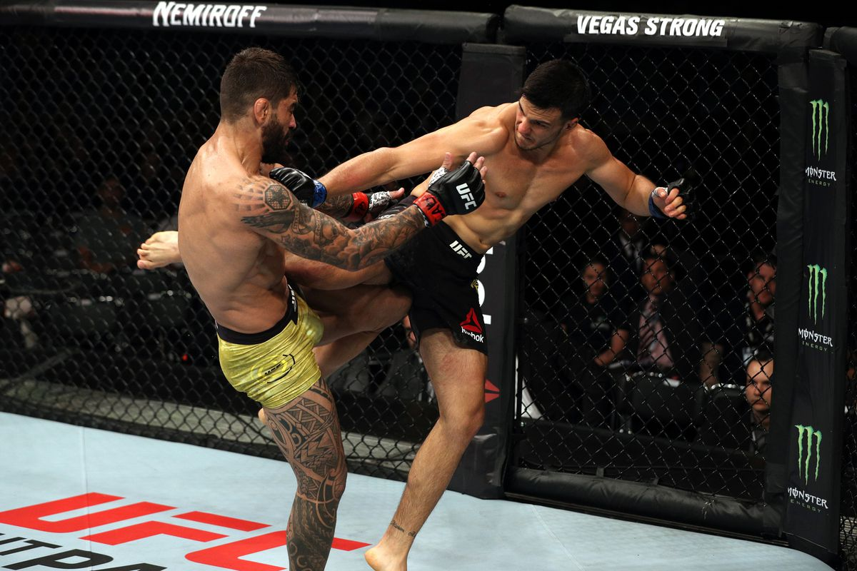 Luigi Vendramini of Brazil kicks Elizeu Zaleski dos Santos of Brazil in their welterweight bout during the UFC Fight Night event at Ibirapuera Gymnasium on September 22, 2018 in Sao Paulo, Brazil.