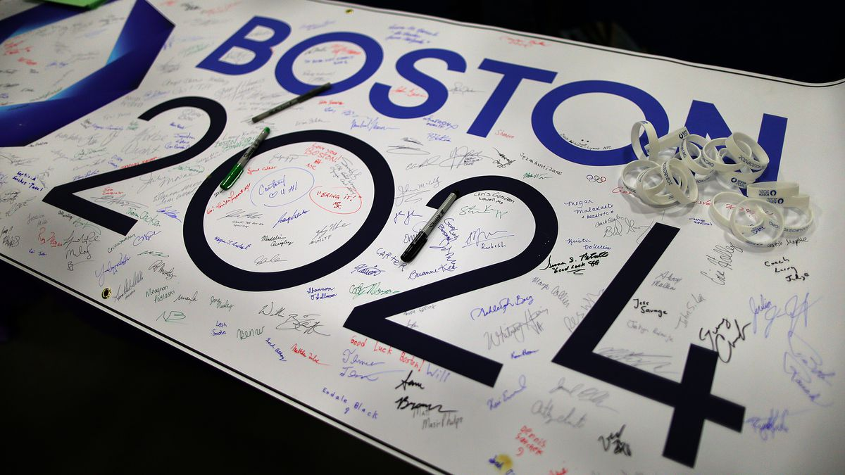 A banner that says Boston 2024, and there are signatures all over the banner.