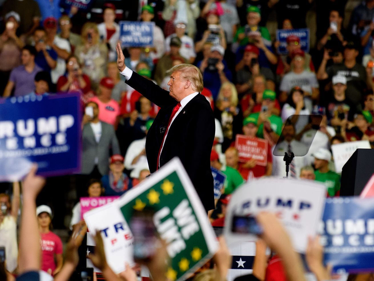 President Donald Trump acknowledges the crowd at a rally at the Erie Insurance Arena on October 10, 2018, in Erie, Pennsylvania.