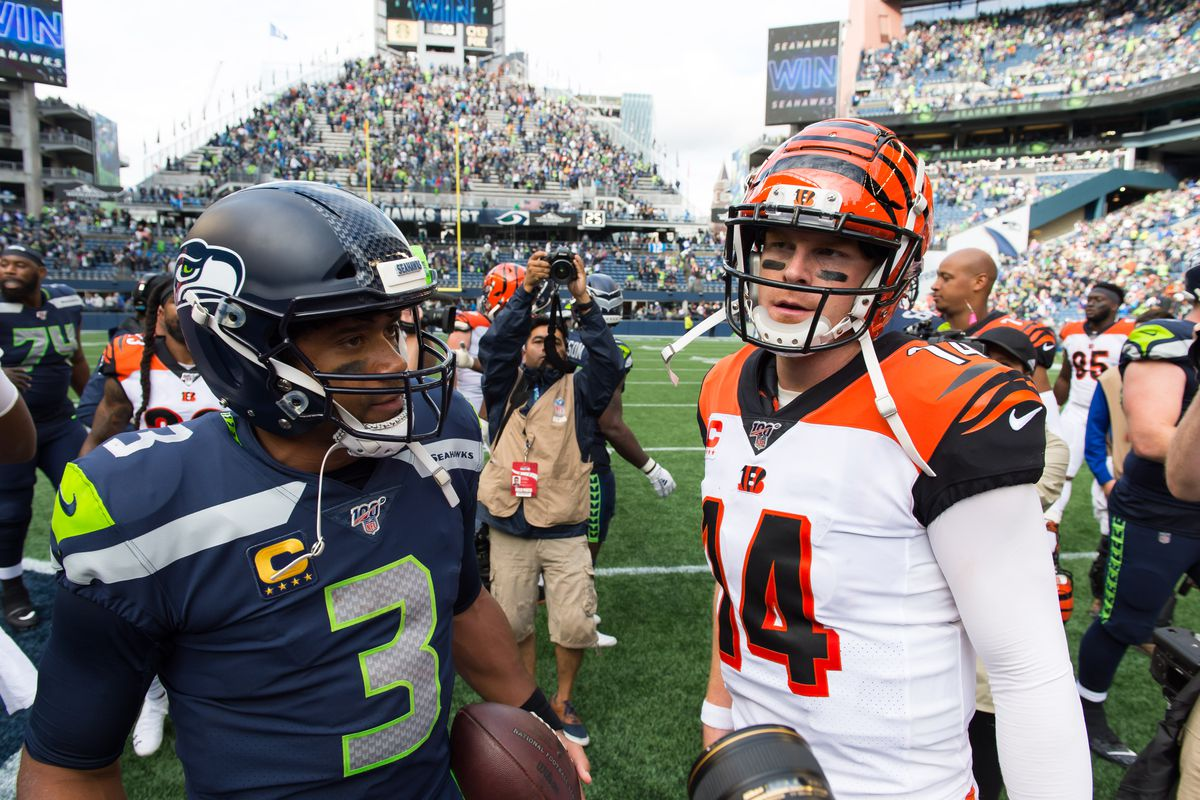 Seattle Seahawks quarterback Russell Wilson and Cincinnati Bengals quarterback Andy Dalton greet each other after the game between the Seahawks and the Bengals at CenturyLink Field. Seattle defeated Cincinnati 21-20.