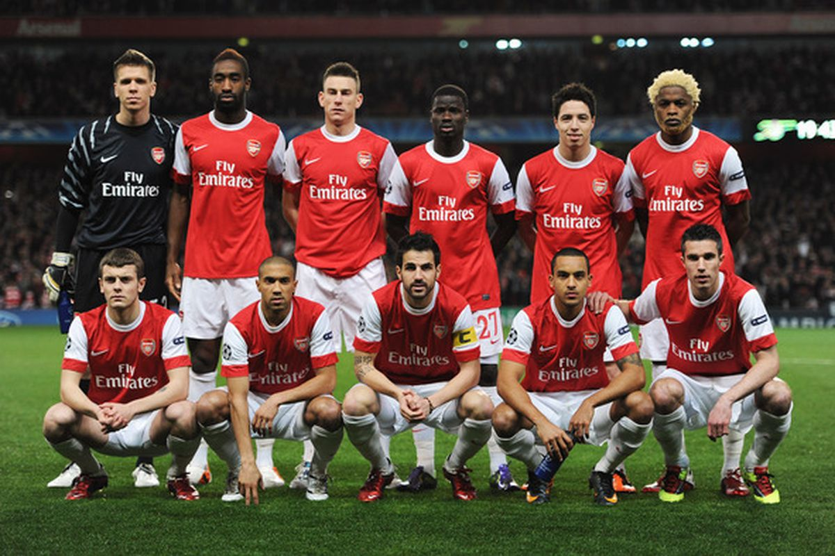 LONDON ENGLAND - FEBRUARY 16: The Arsenal team poses prior to the UEFA Champions League round of 16 first leg match between Arsenal and Barcelona at the Emirates Stadium on February 16 2011 in London England.  (Photo by Jasper Juinen/Getty Images)
