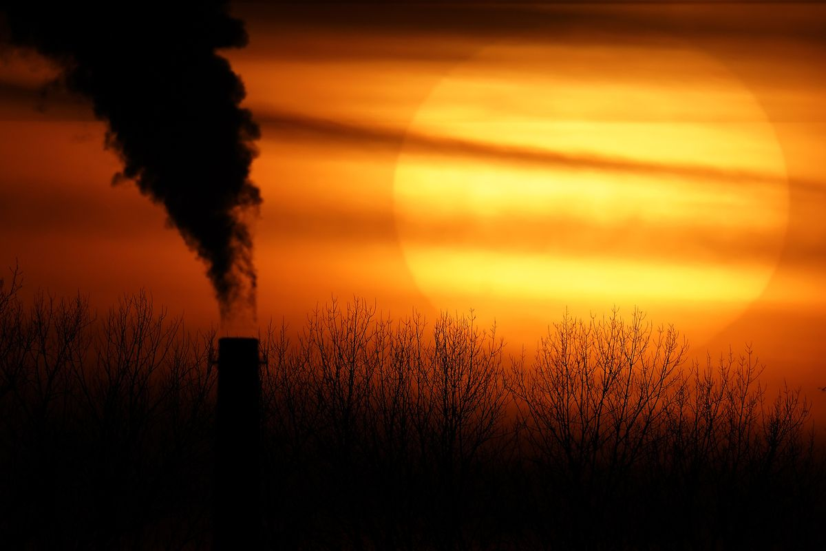 In this Monday, Feb. 1, 2021 file photo, emissions from a coal-fired power plant are silhouetted against the setting sun in Independence, Mo.