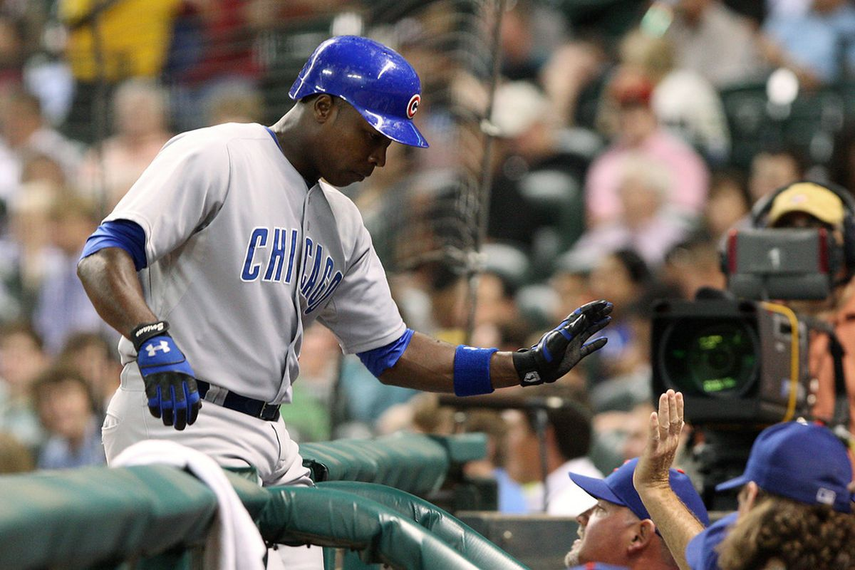 Houston, TX, USA; Chicago Cubs outfielder Alfonso Soriano  is congratulated by teammates after hitting a home run against the Houston Astros at Minute Maid Park. Credit: Troy Taormina-US PRESSWIRE