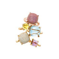 Paloma's Sugar Stacks rings (from top): pink sapphires in 18 karat rose gold, $4,500; yellow quartz in 18 karat gold, $675; blue topaz in 18 karat yellow gold, $1,350; diamonds in 18 karat yellow gold, $5,500; and lavender amethyst in 18 karat yellow gold