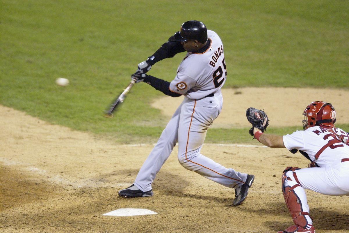 Barry Bonds puts the ball in play