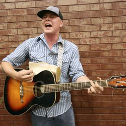 """Logan McDowall, from Ontario, Oregon, sings and plays guitar while waiting in line for """"American Idol"""" auditions at the Northwest Community Center in Salt Lake City on Thursday, Aug. 29, 2019."""