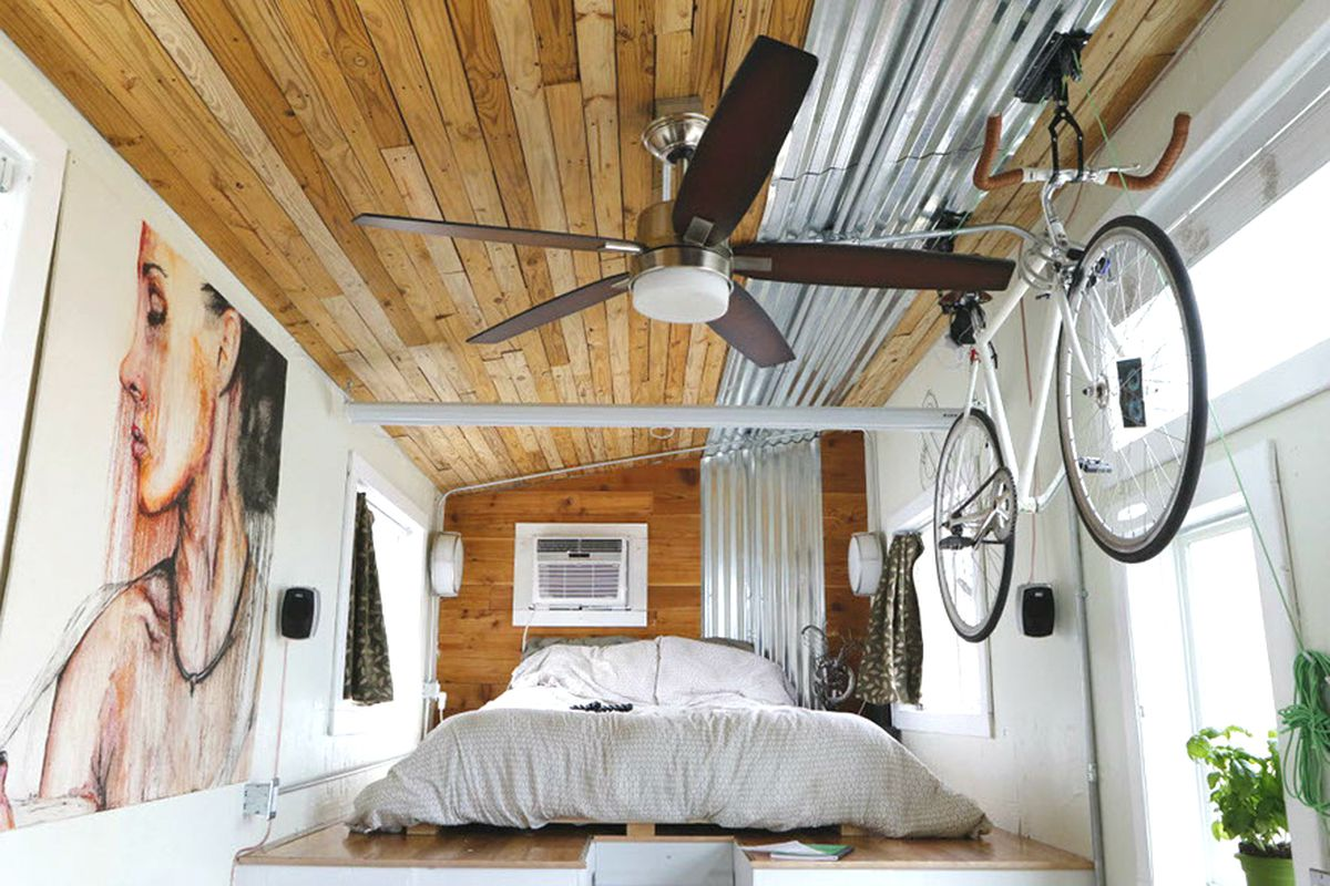interior of tiny house with ceiling fan and bike rack