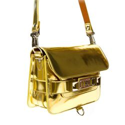 """Proenza Schouler <a href=""""http://www.openingceremony.us/entry.asp?pid=6140"""">created</a> a miniature PS11 in gold exclusively for OC."""