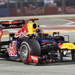 Red Bull Formula One driver Sebastian Vettel of Germany steers his car during the Singapore Formula One Grand Prix on the Marina Bay City Circuit in Singapore, Sunday, Sept. 23, 2012.