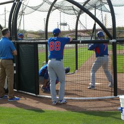 Brett Jackson hits with Theo Epstein watching closely