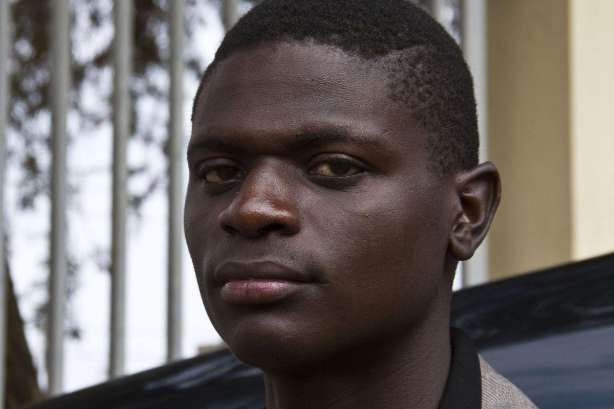 Jackson Mukasa poses outside the Buganda road Magistrates Court on June 12, 2014.