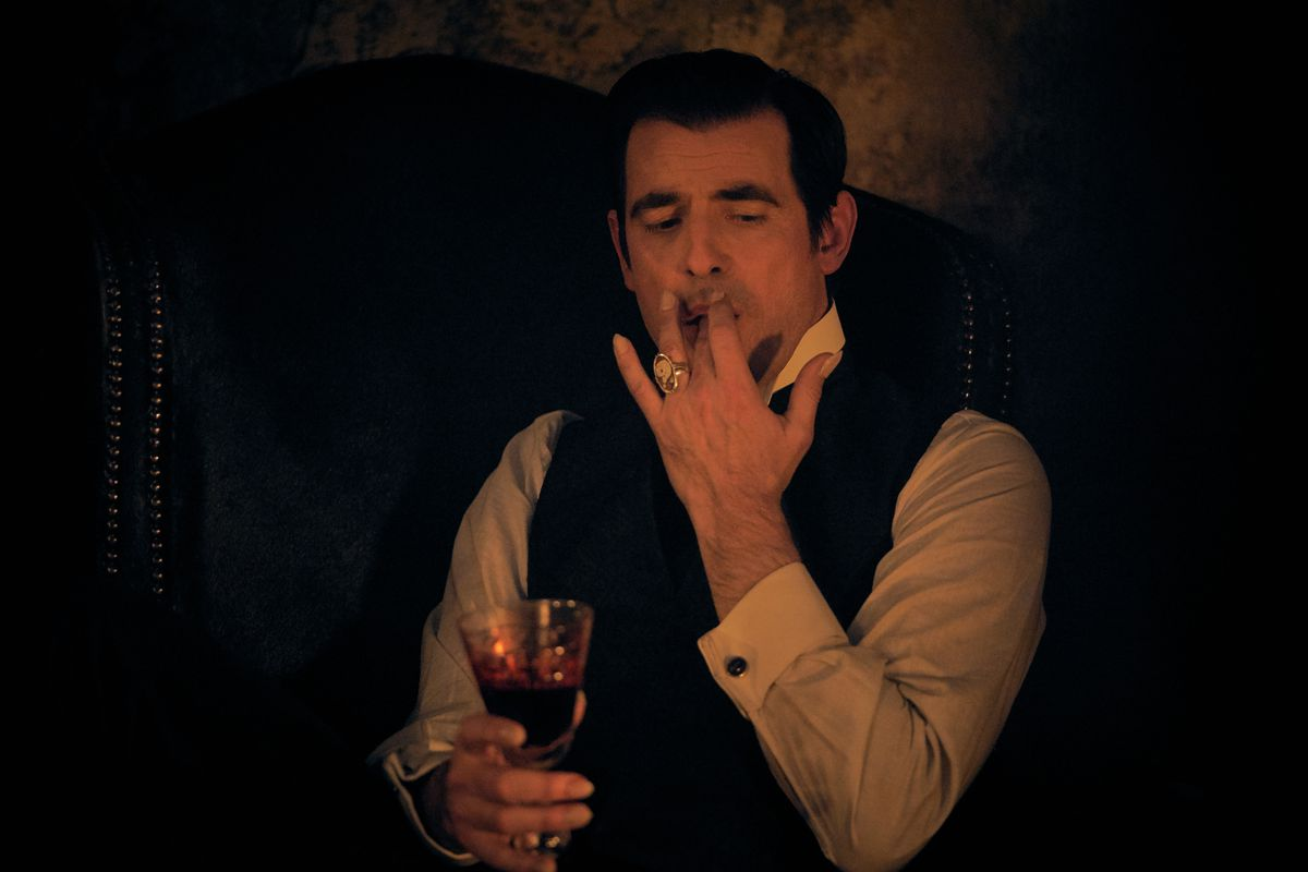 Dracula (Claes Bang) sucking blood off of his fingers in a still from the Netflix and BBC show Dracula