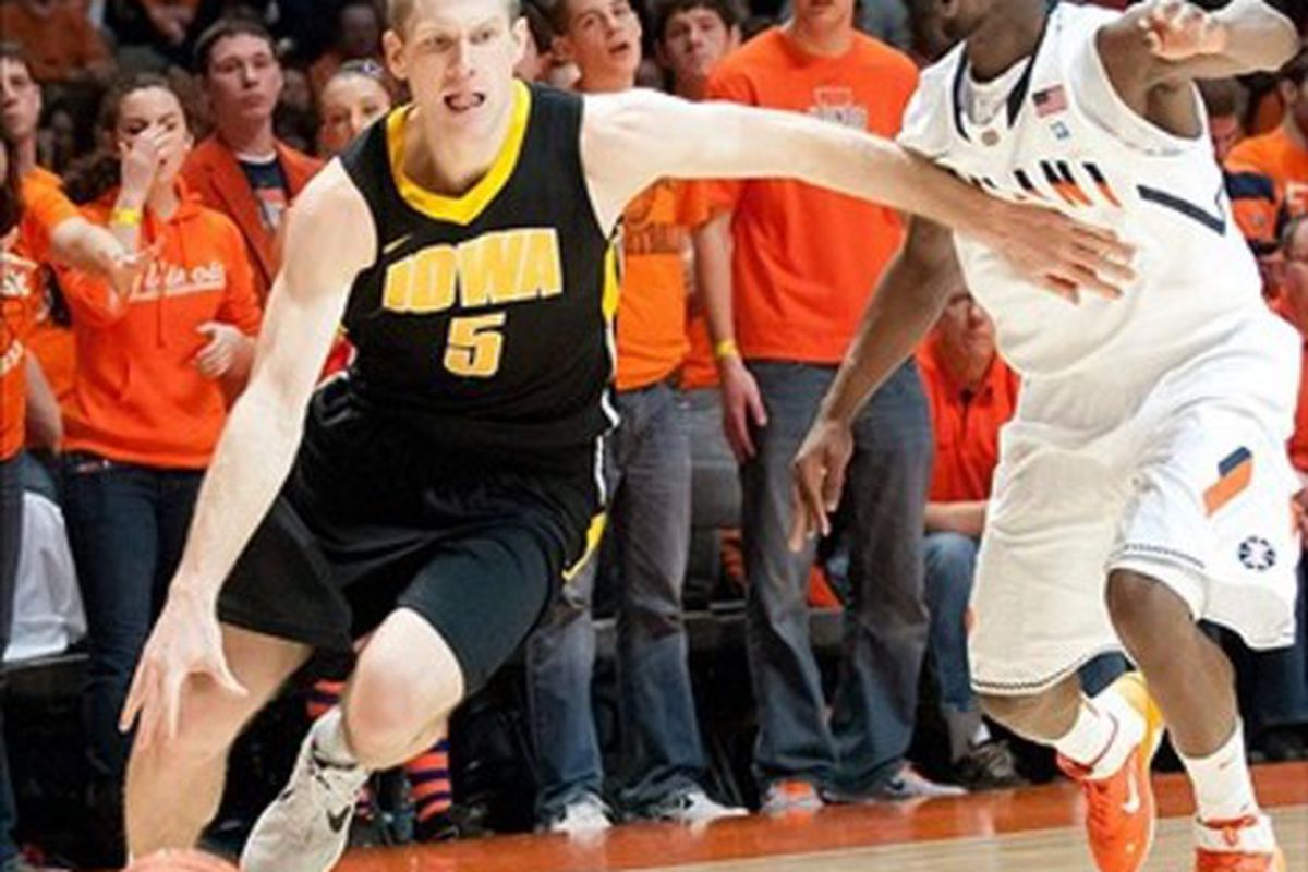 Feb 26, 2012; Champaign, IL, USA; Iowa Hawkeyes guard Matt Gatens (5) drives to the basket while being defended by Illinois Fighting Illini guard D.J. Richardson (1) during the first half at Assembly Hall. Mandatory Credit: Bradley Leeb-US PRESSWIRE
