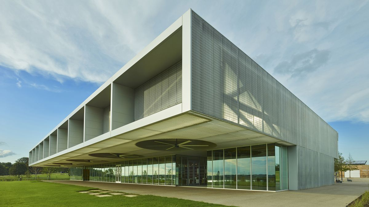 A diagonal view at a rectilinear building with a large overhang.