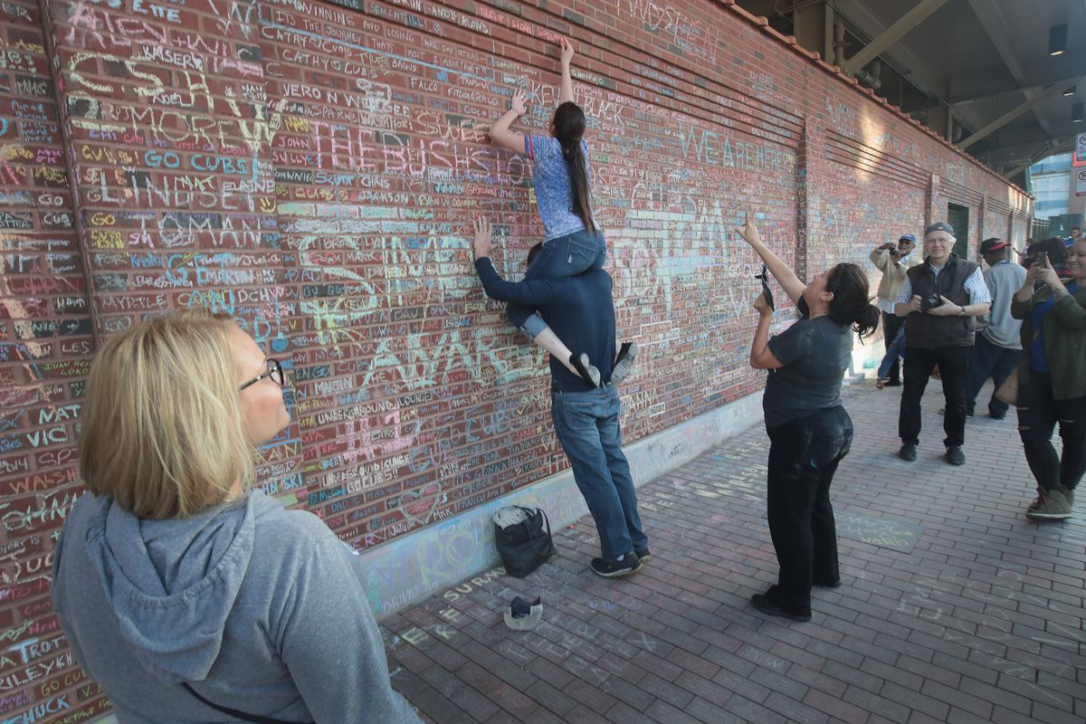 Cubs Fans Leave Messages For The World Series Champion Team On Wrigley Field Walls