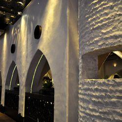 Stucco walls and Moorish windows face the casino floor.