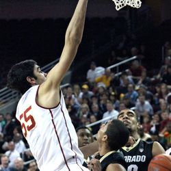 Omar Oraby throws down the dunk.