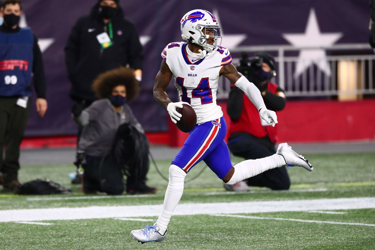Stefon Diggs #14 of the Buffalo Bills runs the ball into the end zone for a touchdown during the first half against the New England Patriots at Gillette Stadium on December 28, 2020 in Foxborough, Massachusetts.