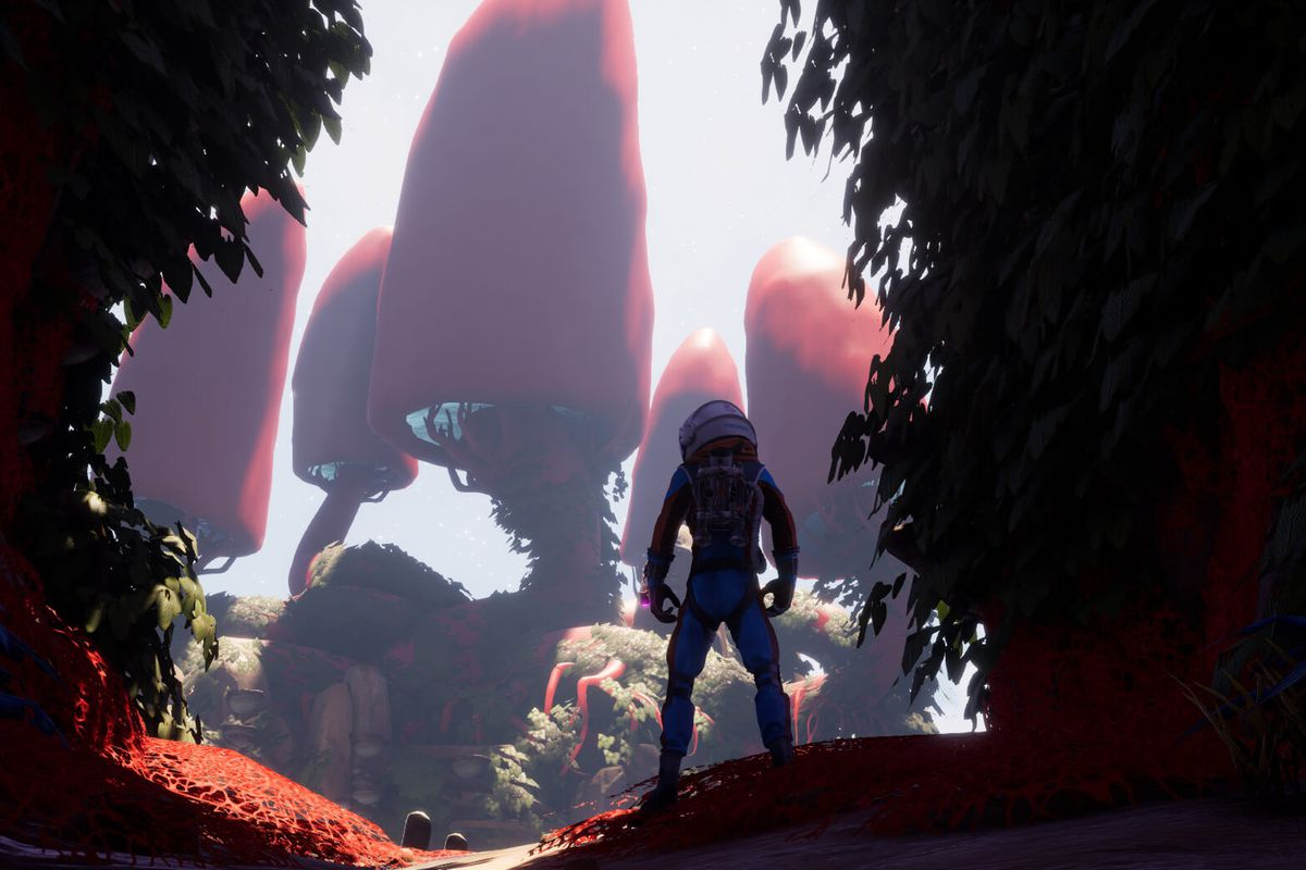 A space explorer overlooks an alien planet landscape in a screenshot from Journey to the Savage Planet