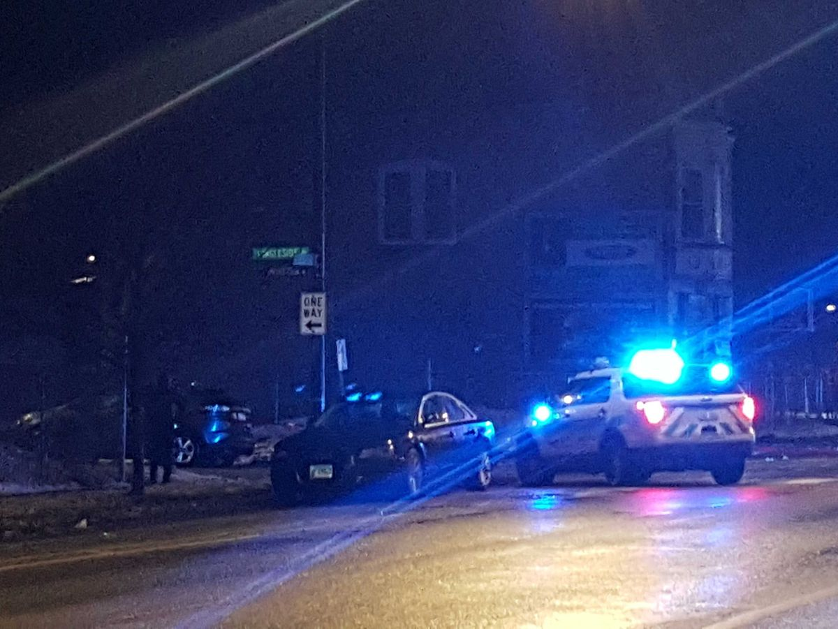 Chicago police investigate a shooting outside Reynold's Lounge that left at least four people wounded. | Kathy Chaney/Sun-Times