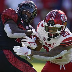 San Diego State running back Greg Bell (22) is tackled by Utah safety Brandon McKinney (28) during the first half of an NCAA college football game Saturday, Sept. 18, 2021, in Carson, Calif.