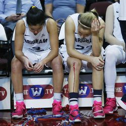 Brigham Young Cougars guard Kylie Maeda (3) and Brigham Young Cougars guard Makenzi Morrison Pulsipher (23) sit on the bench after losing to the San Francisco Lady Dons during the WCC tournament championship in Las Vegas Tuesday, March 8, 2016. San Francisco won 70-68.
