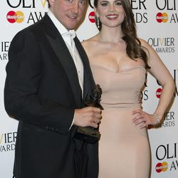 British actor, Bertie Carvel, and British actress, Hayley Atwell, poses with his award for Best Actor in a Musical at the Olivier Awards at the Royal Opera House, London,  Sunday, April 15, 2012.