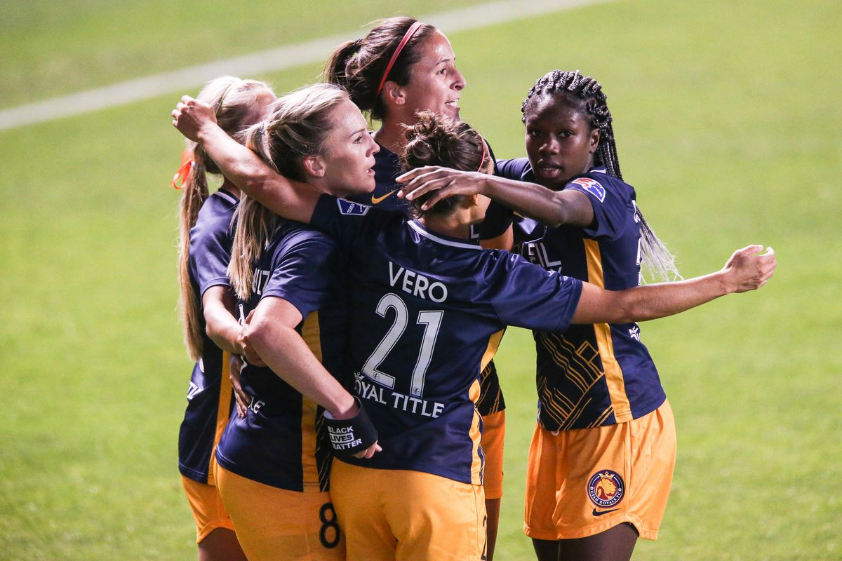 Utah Royals FC players celebrate after forward Amy Rodriguez (8) scores their first goal against Portland Thorns FC during an NWSL soccer game at Rio Tinto Stadium in Sandy on Saturday, Oct. 3, 2020.
