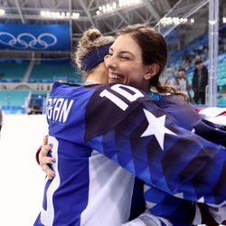 Gold medal winners Meghan Duggan #10 and Hilary Knight #21 of the United States celebrate.