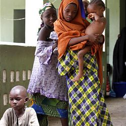 Children of suspected Islamist sect members seen at a police station, where they have been kept for their safety during violence in recent days, at  Maiduguri, Nigeria, Sunday.