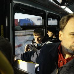 """Passengers making their way to Salt Lake from Ogden are forced to utilize a """"bus bridge"""" between the Layton and Woods Cross stations following the closure of the FrontRunner line due to high winds Thursday morning, December 1, 2011."""