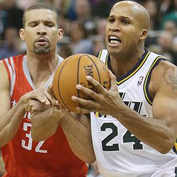 Utah Jazz's small forward Richard Jefferson (24) is held and fouled as he tries to drive past Houston's Francisco Garcia as the Jazz and the Rockets play Saturday, Nov. 2, 2013 in EnergySolutions arena. Jazz lost 104-93.