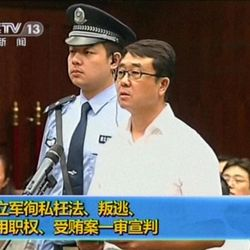 In this video image taken from CCTV, Wang Lijun speaks during his trial at the Chengdu Intermediate People's Court in Chengdu, southwest China's Sichuan province, Monday, Sept. 24, 2012.   Wang, the Chinese police chief whose thwarted defection exposed murder and infighting in high places was sentenced to 15 years in prison Monday, setting the stage for China's leadership to close out the divisive scandal and move ahead with a generational handover of power.