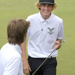 Ridgeline's Isaac Petersen, right, smiles after Fletcher Hamblin made a putt during a one hole playoff against Crimson Cliffs during the second round of the 4A boys state golf tournament on Thursday, Oct. 7, 2021, in Smithfield.