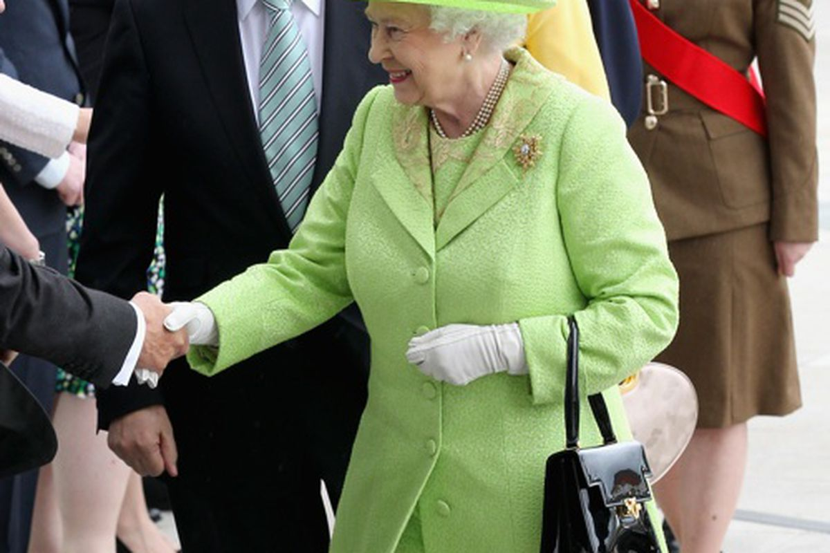 The Queen fosters a fashion frenzy with that patent leather Launer London bag, via Getty