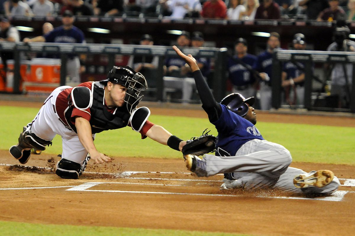 PHOENIX, AZ - AUGUST 31:  Catcher Miguel Montero #26 of the Arizona Diamondbacks tags out a sliding Dexter Fowler #24 of the Colorado Rockies at Chase Field on August 31, 2011 in Phoenix, Arizona.  (Photo by Norm Hall/Getty Images)