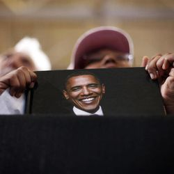 Ahnia Logan, 11, from Toledo, Ohio, holds a book cover with the image of President Barack Obama during a campaign event at Bowling Green State University, Wednesday, Sept. 26, 2012, in Bowling Green, Ohio.