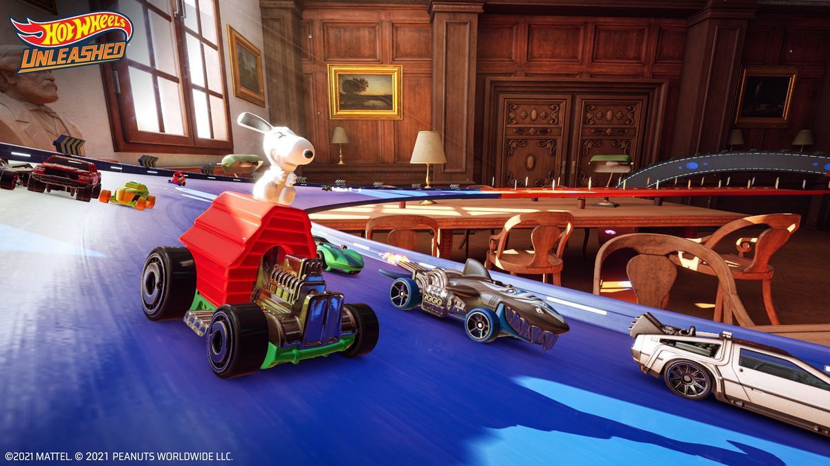 Snoopy aboard his doghouse, next to the Back to the Future DeLorean and the Sharkruiser in Hot Wheels Unleashed