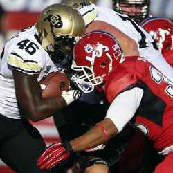 Colorado's Christian Powell (46) rushes against Fresno State's Patrick Su'a in the first quarter of an NCAA college football game in Fresno, Calif., Saturday, Sept. 15, 2012.