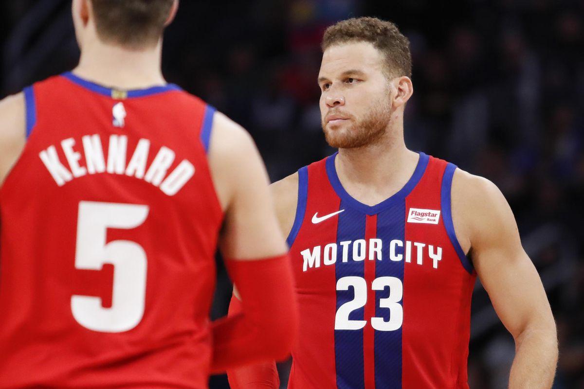 Detroit Pistons forward Blake Griffin walks toward guard Luke Kennard during the second quarter against the Charlotte Hornets at Little Caesars Arena.