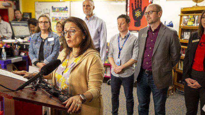 Denver Public Schools Superintendent Susana Cordova speaks at a podium.
