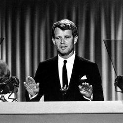 """FILE - In this Aug. 28, 1964, file photo, Sen. Robert Kennedy stands before the delegates at the Democratic National Convention in Atlantic City, N.J. Democrats have little hope of matching the fervor and historical import of their 2008 convention, when they made Barack Obama the first black presidential nominee of a major political party. One of the memorable moments from past conventions was delegates standing in tearful silence as Robert Kennedy quotes Shakespeare in tribute to his slain brother, President John F. Kennedy: """"When he shall die, take him and cut him out into stars, and he shall make the face of heaven so fine that all the world will be in love with night and pay no worship to the garish sun.""""  (AP Photo)"""