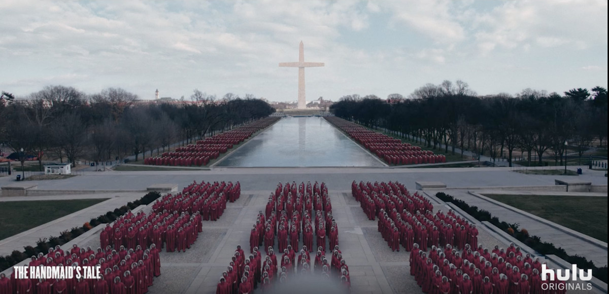 Image of women in red gowns lined up in rows on the National Mall