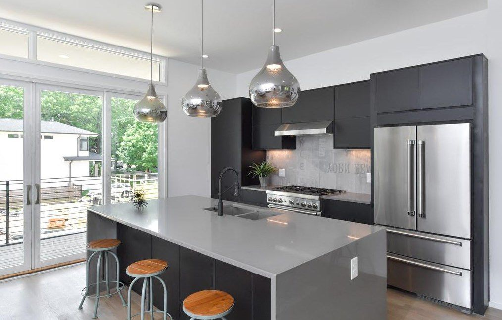 A white and gray kitchen in a townhome.
