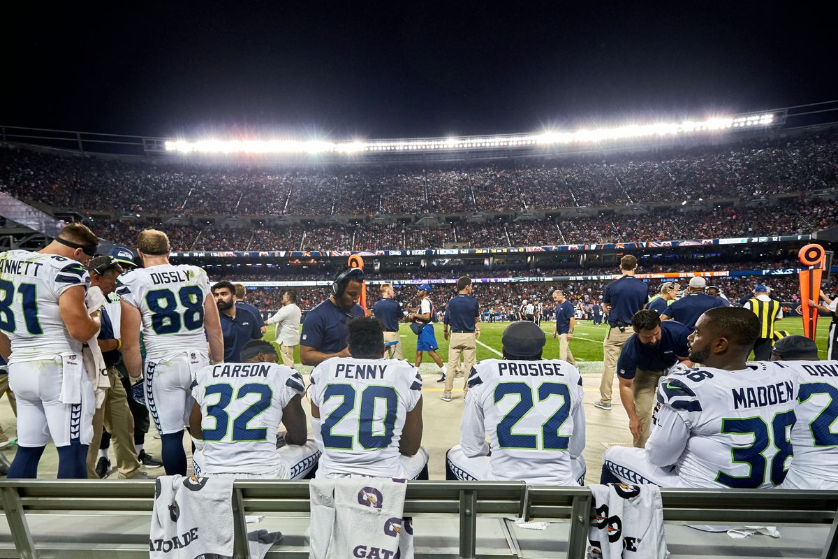 Seattle Seahawks running backs Chris Carson Rashaad Penny, C.J. Prosise, and defensive back Tevon Mutcherson watch the game from the bench during an NFL game between the Chicago Bears and Seattle Seahawks on September 17, 2018 at Soldier Field.