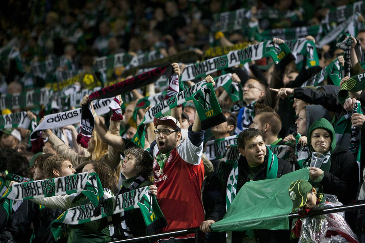 PORTLAND, OR - OCTOBER 14:  The Timbers Army, fans of the Portland Timbers, cheer at Jeld-Wen Field on October 14, 2011 in Portland Oregon. The Dynamo won over the Timbers 2-0. (Photo by Jay Drowns/Getty Images)