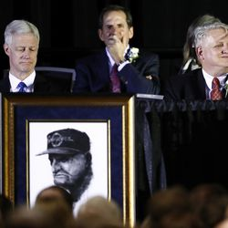 BYU President Kevin J. Worthen, left, sits next to Jimmy Edwards, son of LaVell Edwards, during a public memorial service for former Cougar football coach LaVell Edwards at the Provo Convention Center on Friday, Jan. 6, 2017.