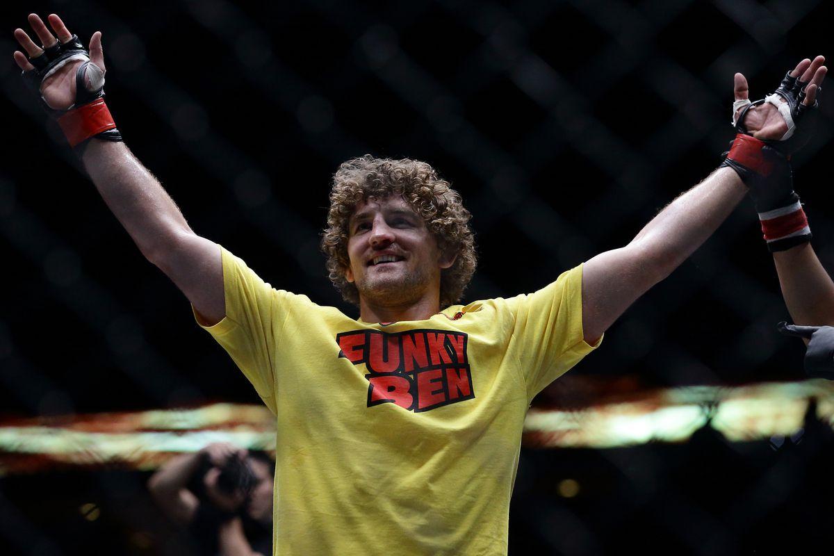 """Ben Askren wearing a yellow T-shirt reading """"Funky Ben"""""""